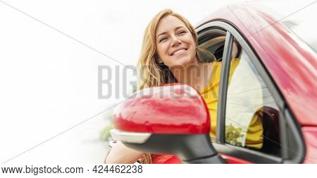 Happy Beautiful Young Woman Drives A Car.