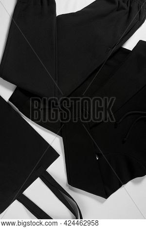 Dark Clothing Lying On A White Isolated Background. New Collection Of Cool Apparel Presented In The