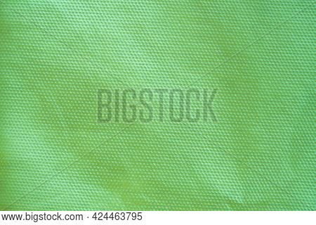 Fine Synthetic Fabric With Mesh Texture, Altered Color, Pale Green