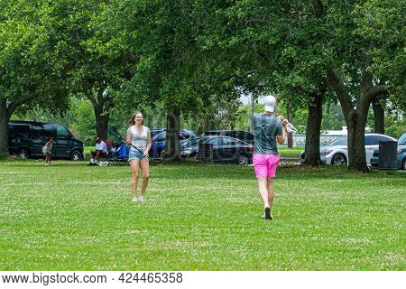 New Orleans, La - May 28: Couple Playing Lacrosse In The Park On May 28, 2021 In New Orleans, La, Us