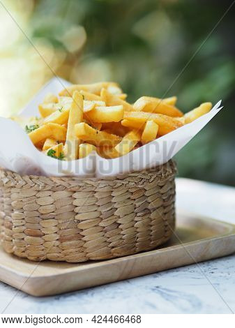 French Fries, Potato Chips Yellow Crispy Fries In Wooden Basket On White Table, Snack Delicious