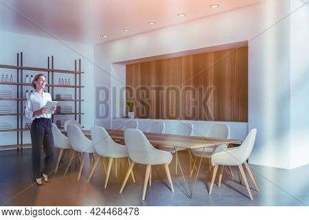 Business Woman Holding Tablet Device And Waiting For Clients To The Modern Luxury Spa Center In Down