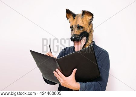 Person With A Dog Mask Taking Notes In A Notebook On White Background, Concept Of A Reliable Veterin