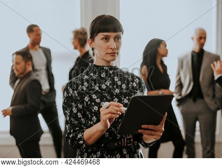 Empowering businesswoman using a digital tablet