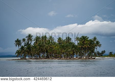 Tiny Tropical, Uninhabited Island With Coconut Palm Trees And. Vacation, Adventure And Travel Concep
