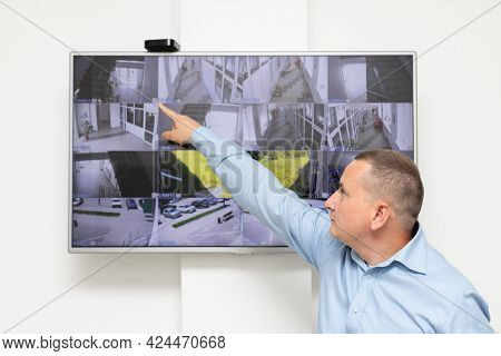 Security Guard Standing In Front Of Large Cctv Monitor. Surveillance Security System, Modern Technol