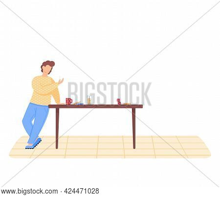Man Stands Near Brown Table With Sweets, Cup, Glass Of Juice And Dice. Boy Smiles And Plays Board Ga
