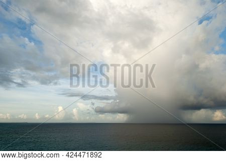 The Early Morning View Of A Dark Rainy Cloud With A Rainbow Coming Toward Grand Turk Island (turks A