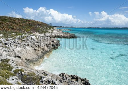 The Scenic View Or Rocky Steep Coastline And Turquoise Color Transparent Water On Half Moon Cay (bah