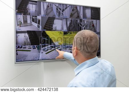 Security Guard Monitoring Surveillance Security System On Large Cctv Monitor. Surveillance, Modern T