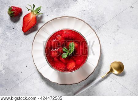Vegan Panna Cotta With Strawberry Sauce And Mint On Gray Background. Healthy Vegan Dessert Concept.