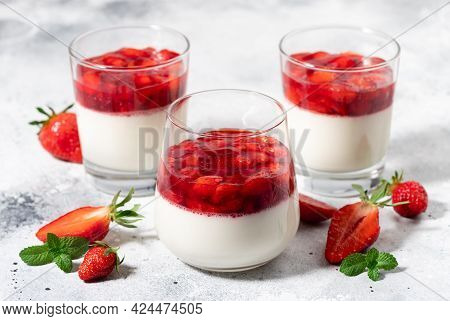 Creamy Vegan Panna Cotta With Coconut And Strawberries In Glasses On Gray Background. Traditional It
