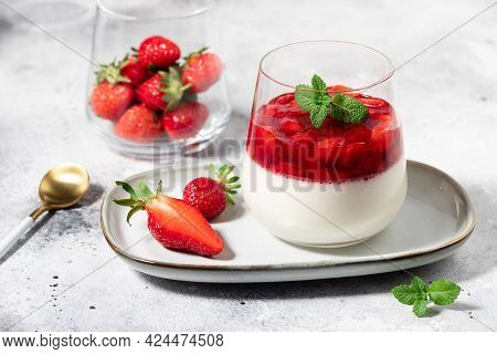 Vegan Panna Cotta With Coconut And Strawberries In Glass On Gray Background. Healthy Vegan Dessert C