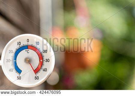 Outdoor thermometer with celsius scale shows extreme hot temperature 50 degree - summer heatwave concept