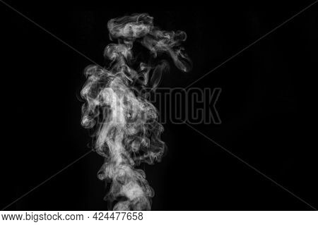 Perfect Mystical Curly White Steam Or Smoke Isolated On Black Background. Abstract Background Fog Or