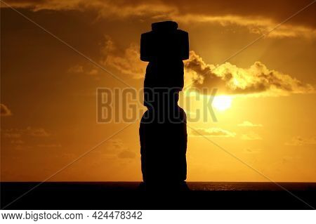 Silhouette Of A Moai Statue Of Ahu Ko Te Riku Against Sunset Sky Over The Pacific Ocean, Historic Pl