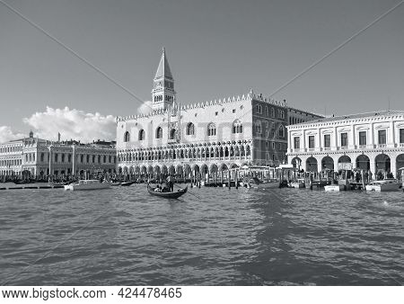 Doge's Palace And The Companile Bell Tower On The Grand Canal Bank With A Gondola, Venice, Italy, 22