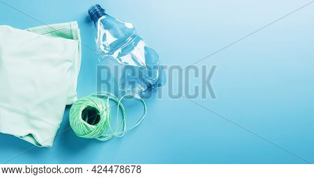 The Concept Recycling Plastic. Empty Plastic Bottle And Recycled Polyester Fiber, Synthetic Fabric B