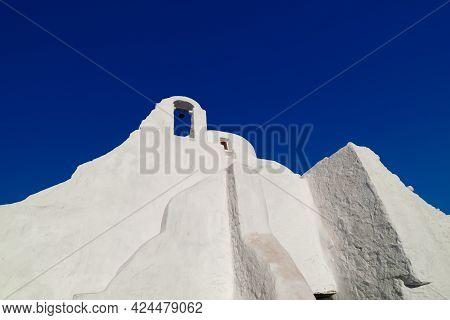 Famous Tourist Landmark, Mykonos Island, Greece. White Greek Orthodox Church Of Panagia Paraportiani