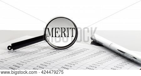 Magnifying Glass With Text Merit On Chart Background With Pen