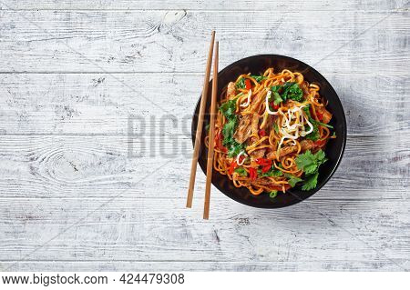Fried Soy Meat Strips With Spicy Egg Noodle,  Bean, Sprouts, Kale, Cilantro And Chili In A Bowl With