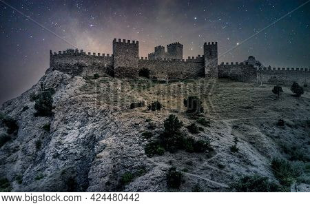 Medieval Castle On A High Rock At Night. Stars On The Sky. Medieval Genoese Fortress In Crimea, Russ
