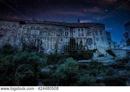 Medieval Castle On Top Of A Cliff. Starry Sky Above The Castle. Castle In Cesky Krumlov. Czech Repub