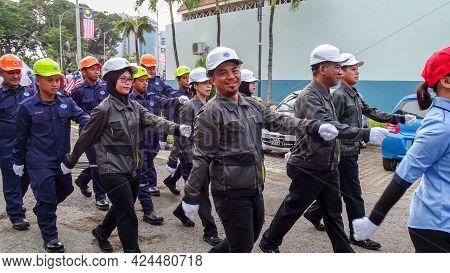 Labuan,malaysia-sept 16,2018:labuan Corporation Staffs In Uniform During Malaysia National Day Parad