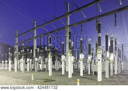 View Of An Illuminated Electric Substation Plant At Night