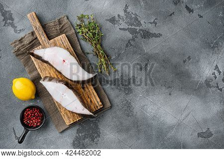 Piece Of Fresh Raw Halibut Fish Set, With Ingredients And Rosemary Herbs, On Gray Stone Table Backgr