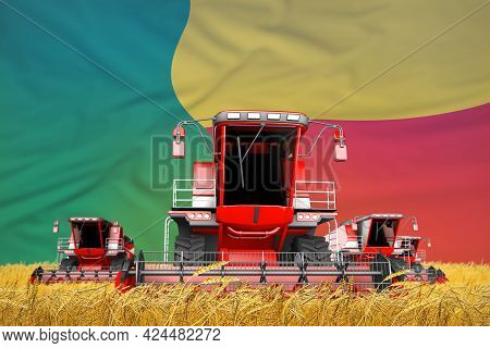 Four Bright Red Combine Harvesters On Farm Field With Flag Background, Benin Agriculture Concept - I