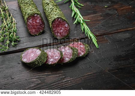 Traditional Sausage Salami Fuet, Cut To Slices On Dark Wooden Background.