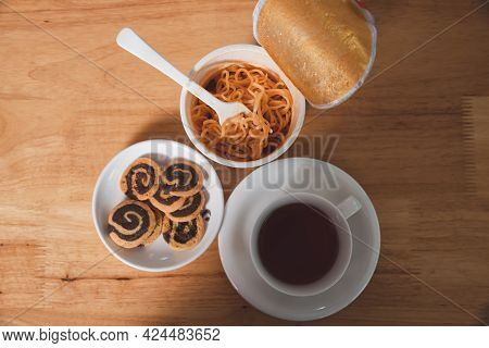 Top View Of Instant Noodles, Cookies And Tea On Desk. Tea Time, Break Time.