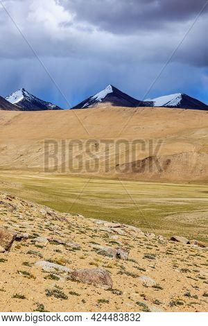 Himalayan landscape with snowcapped Himalayas mountains near Kyagar Tso lake, Ladakh, India
