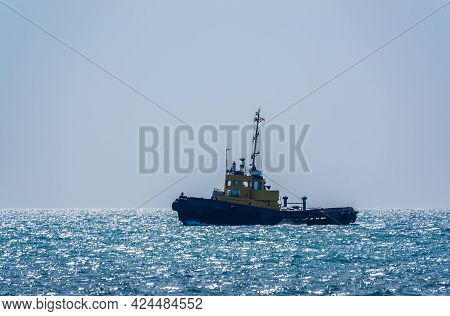 The Tug Ship Is Sailing On The Blue Sea. Blue Sea With Ship On The Background