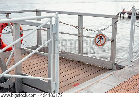 River Pier With A Sign