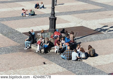 Madrid, Spain - April, 18 2021: People Enjoying Sitting On Floor Of Plaza Mayor Square In Central Ma
