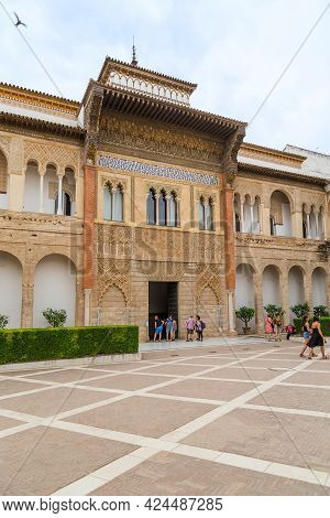Seville, Spain - May 21, 2017: This Is The Front Facade With The Entrance Of The Moorish Palace In T