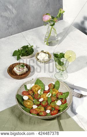 Composition With Salad And Cocktail. Composition With A Salad Made Of Tomatoes, Spinach, Basil, Chee