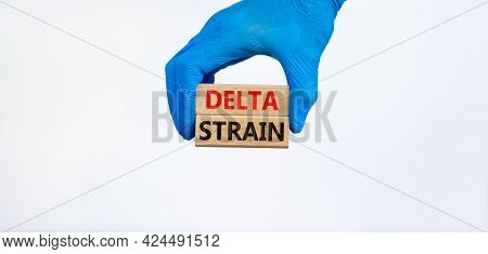Covid-19 New Delta Strain Symbol. Hand In Blue Glove Holds Wooden Blocks Words 'delta Strain'. Beaut