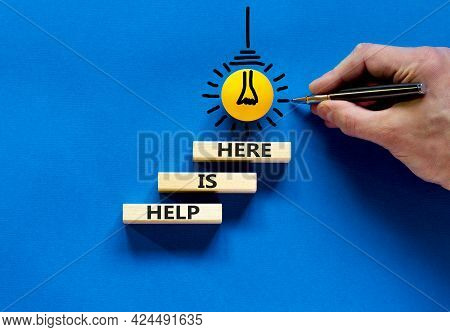 Help Is Here Symbol. Wooden Blocks With Words 'help Is Here' On Beautiful Blue Background. Businessm
