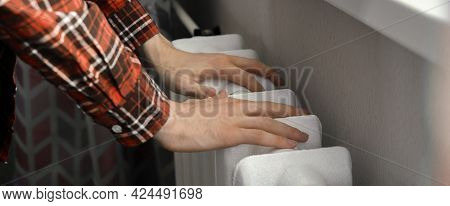 The Frozen Hands Touch A Heating Battery At Home During Winter Season