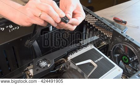 Hands Assemble Cpu Cooler And Nvidia Geforce Rtx 3080 Graphics Card In Pc. Man Check Power Supply Ca