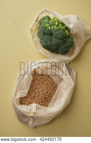 Various Vegetables, Pasta, Mushrooms And Cereals In Reusable Fabric Eco Bags.