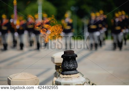 Eternal Flame For The Army Heroes During A Military Ceremony In Bucharest, Romania, At The Tomb Of T