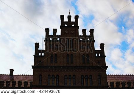 Silhouette Of Majestic Medieval Brick Building Against Cloudy Sky. Residence Of Bukovinian And Dalma