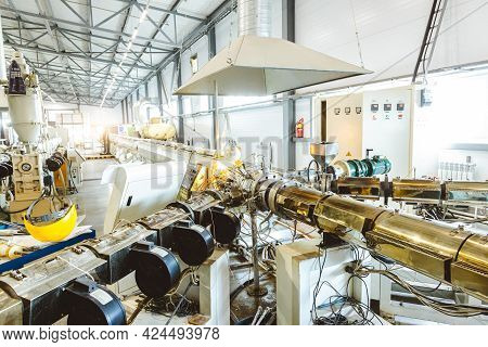 Workshop With Extruders For Producing Plastic Pipes. High Speed Extrusion Line Of Water Suppply And