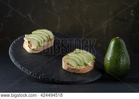 Sliced Avocado Into Wedges. Avocado Slices And A Whole Vegetable. Showcase With Sandwiches. Front Vi