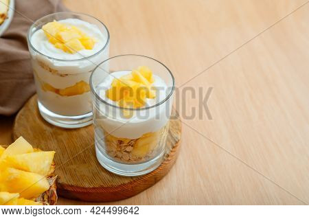 Tasty Pineapple Desserts With Chopped Fresh Juicy Pineapple. Breakfast Dessert With Oat Granola, Gre