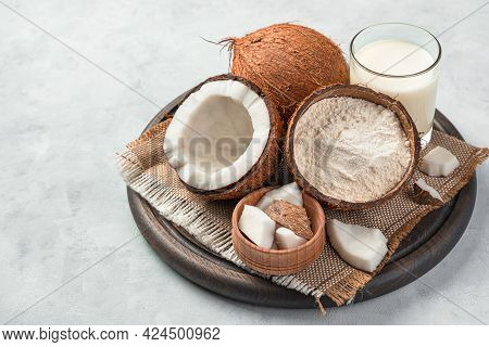 Fresh Coconut And Coconut Products On A Gray Background. Coconut Flour And Coconut Milk.